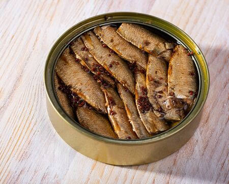 Image of canned small smoked sardines from Riga in open tin can, nobody