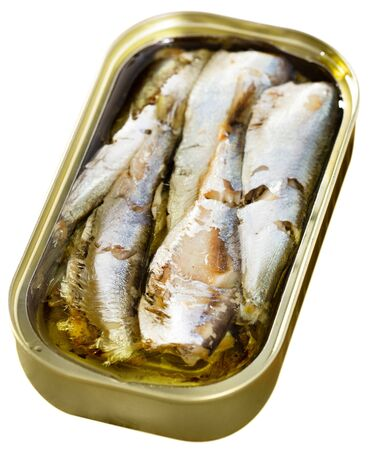 Closeup view of opened can of sardines in oil. Isolated over white background Archivio Fotografico