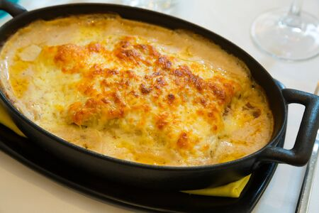 Appetizing Italian lasagna with bechamel sauce, minced meat and melted cheese