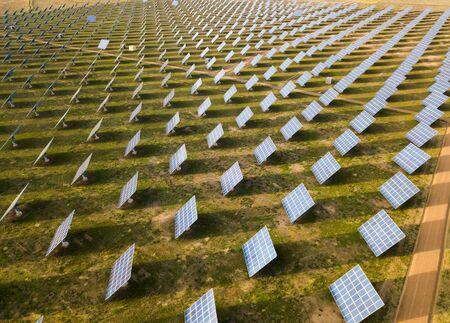 Aerial view of solar panels of power farm producing clean sun energy. Industrial landscape 版權商用圖片