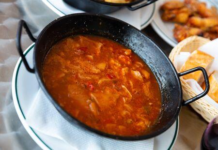 Dish of Spanish cuisine. Stewed tripe (Callos) in salsa with garbanzos and chorizo sausage