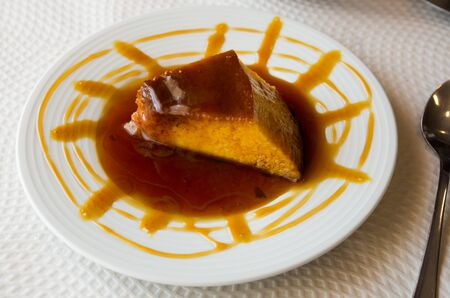 Traditional french dessert creme caramel or flan with sweet syrup