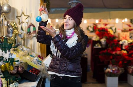 Portrait of happy american female customer near counter with Christmas gifts