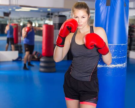 Portrait of young swedish  woman who is training in box gym.