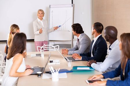 Business woman making presentation on staff meeting at office