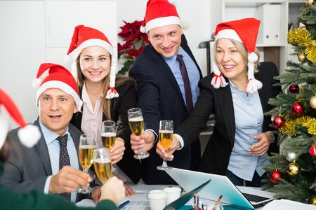 Happy business group people in santa hat at Xmas corporate party Фото со стока