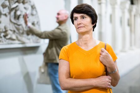 Portrait of woman visiting museum of ancient sculpture for the exhibition