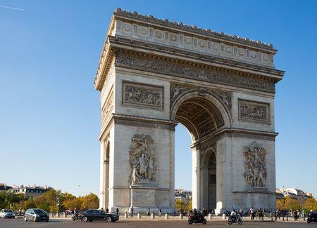 PARIS, FRANCE - OCTOBER 10, 2018: View of famous Arc de Triomphe de l Etoile in Charles de Gaulle square with busy car traffic