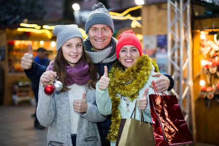 Portrait of laughing family with girl at  Christmas fair Stock Photo