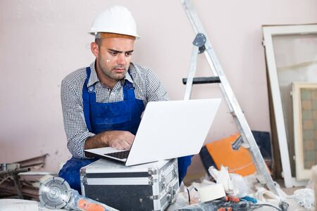 master directs the repair process while sitting behind a laptop