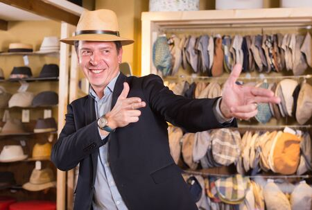 portret of smiling young american guy try on  panama at headwear store Stock Photo
