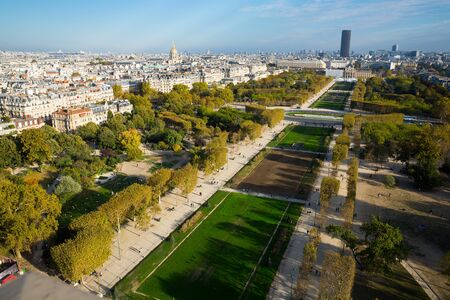 Panoramic view of summer Paris with avenues, houses and trees