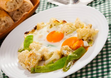 Appetizing cauliflower fried eggs for breakfast Stok Fotoğraf