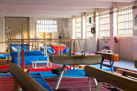 Interior of sport gym with gymnastic equipment