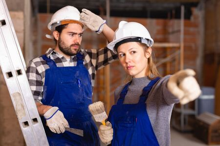 Foreman dissatisfied with quality of repair work of builder Stock Photo - 129816335