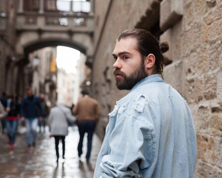 Handsome adult man with a beard in a jeans jacket Stock Photo