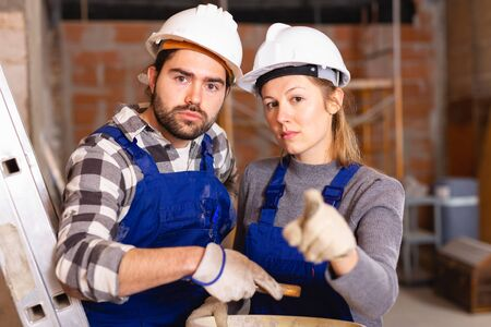 Foreman dissatisfied with quality of repair work of builder Stock Photo - 129816547