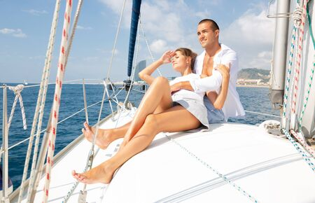 Portrait happy couple sailing on yacht in calm blue sea along Spanish coast during romantic summer vacation Stok Fotoğraf - 129856931