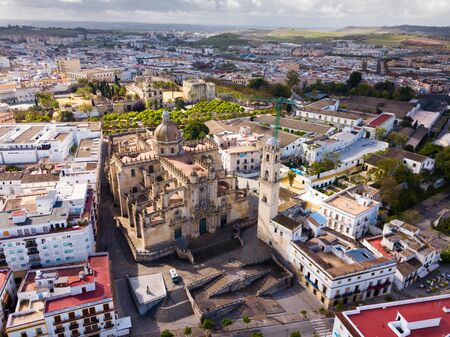 View from drone of residential areas of Spanish town of Jerez de la Frontera with Catholic Cathedral and former Moorish alcazar