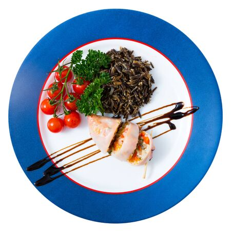 Stuffed squid with peppers, wild rice, eggs and herbs, top view. Isolated over white background