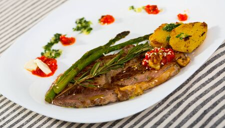 Healthy dinner veal steak baked in oven with different vegetables