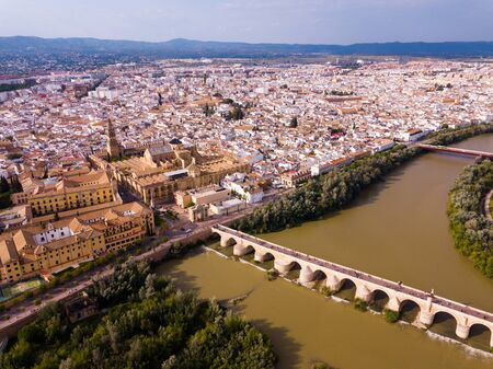 Aerial view of cityscape of Cordoba with  Roman Bridge over the Guadalquivir and the Mosque-Cathedral of Cordoba Stock fotó