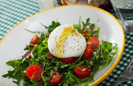 Image of salad with burrata italian cheese, arugula and cherry tomatoes, nobody