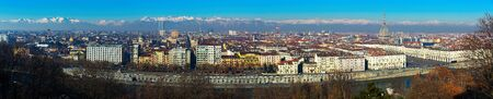 Panorama of Turin against backdrop of snowy Alps in sunny day, Italy Foto de archivo - 129857600