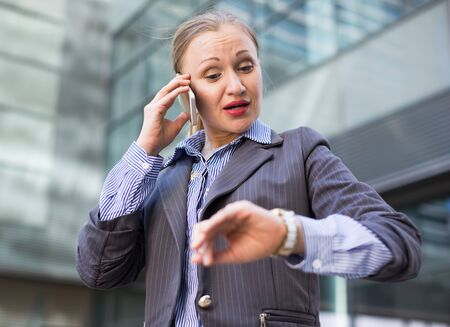 Portrait of busy female in suit rushing to important meeting