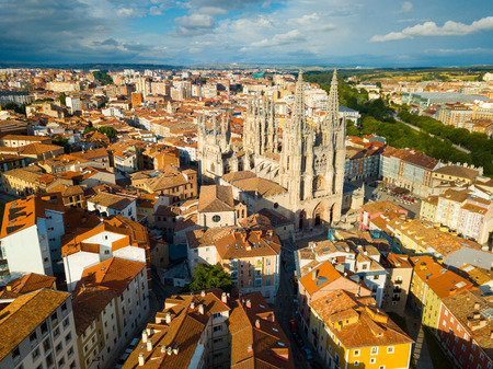 View from drone of impressive Burgos Gothic Cathedral on background of cityscape in summer day, Spain