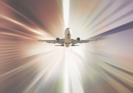 Passenger aircraft flying in sky in divergent glar sunlight Stock fotó