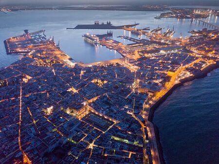 Night general aerial view of lighted Cadiz, Spanish port city overlooking Atlantic Ocean