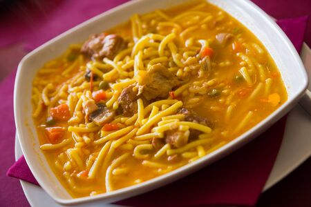 Plate of original spanish dish with noodles, pork and vegetables Stock Photo