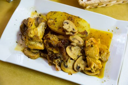 Juicy roasted chicken with baked potato, Champignon and garlic gravy