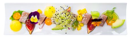 Tasty roasted tuna with mango and avocado served on plate with figs and lime. Isolated over white background Stock fotó