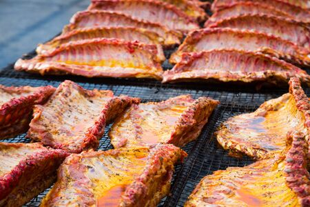 Image of tasty pork ribs preparing on grill brazier outdoors Stockfoto