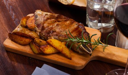 Appetizing beef steak with potatoes and rosemary Stock fotó