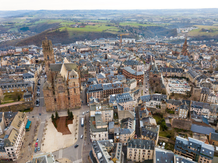Aerial view of residential houses and ancient historical buildings of French city of Rodez in winter day 報道画像
