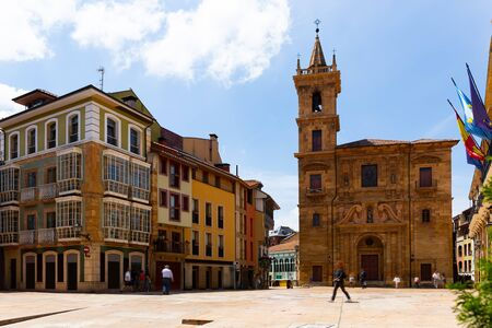 View of ancient San Isidoro El Real Church on central square of Asturian city of Oviedo in sunny summer day, Spain