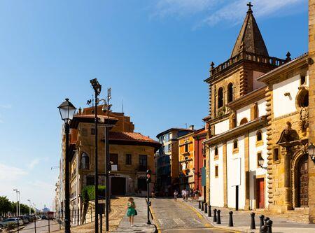 Sunny embankment with old and modern buildings, Gijon, Asturias
