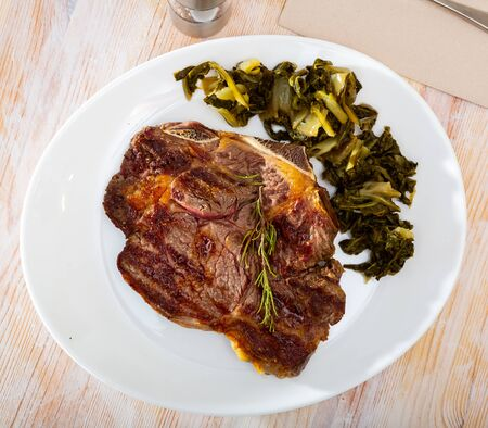 Ternera con acelgas, spanish dish of grilled beef with chard