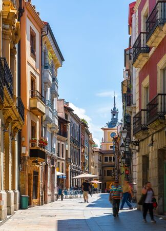 View of narrow pedestrian street of Oviedo with colorful old houses overlooking clock tower of town hall, Asturias, Spain Reklamní fotografie