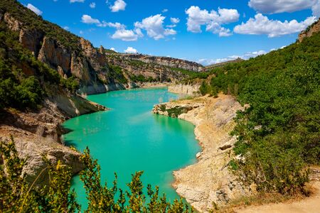 Picturesque rocky landscape of natural masterpiece of Mont-Rebei Gorge with Noguera Ribagorcana River on sunny summer day, Catalonia, Spain
