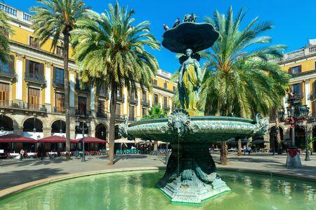 Plaza Real (Royal square) of Barcelona with fountain of Three Graces on sunny summer day, Spain