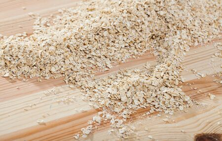 Organic dry oat-flakes natural background