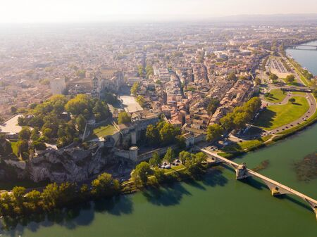 Aerial view of Avignon on bank of Rhone river with Palais des Papes in sunny autumn day, France Stok Fotoğraf - 130418897