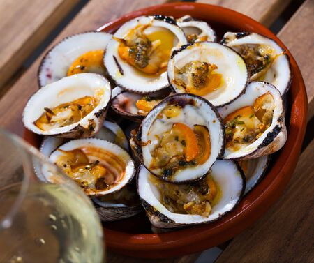 Delicious baked in oven Dog cockles (bivalve shellfishes) served in bowl Stock fotó