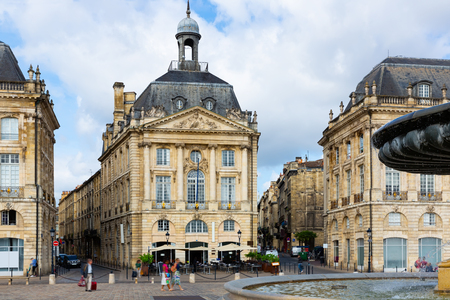View of impressive classical French architecture on Place de la Bourse (former Royal square) in Bordeaux, France