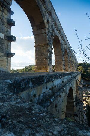 Pont du Gard, ancient Roman aqueduct across Gardon River in southern France Фото со стока