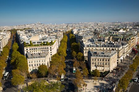 View of Paris autumn cityscape in sunny day from observation deck of Arc de Triomphe, France